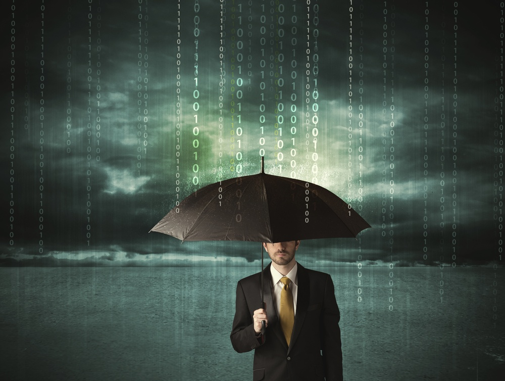 Business man standing with umbrella data protection concept on background.jpeg