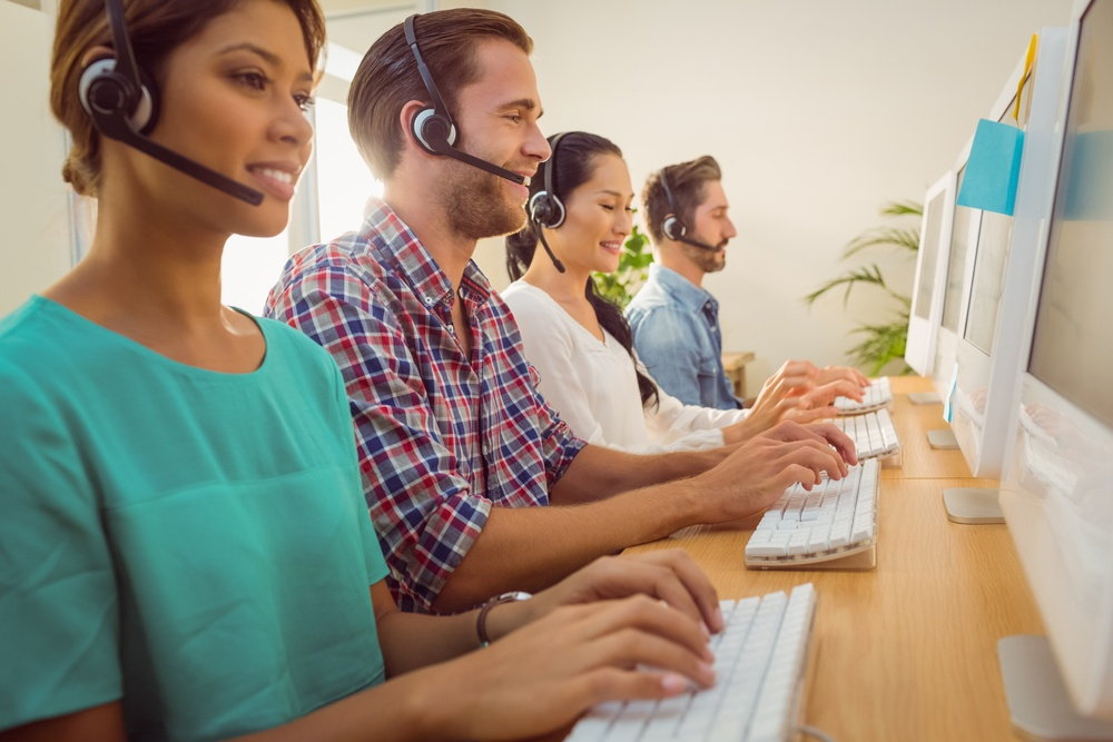 Business team working together at a call centre wearing headsets.jpeg