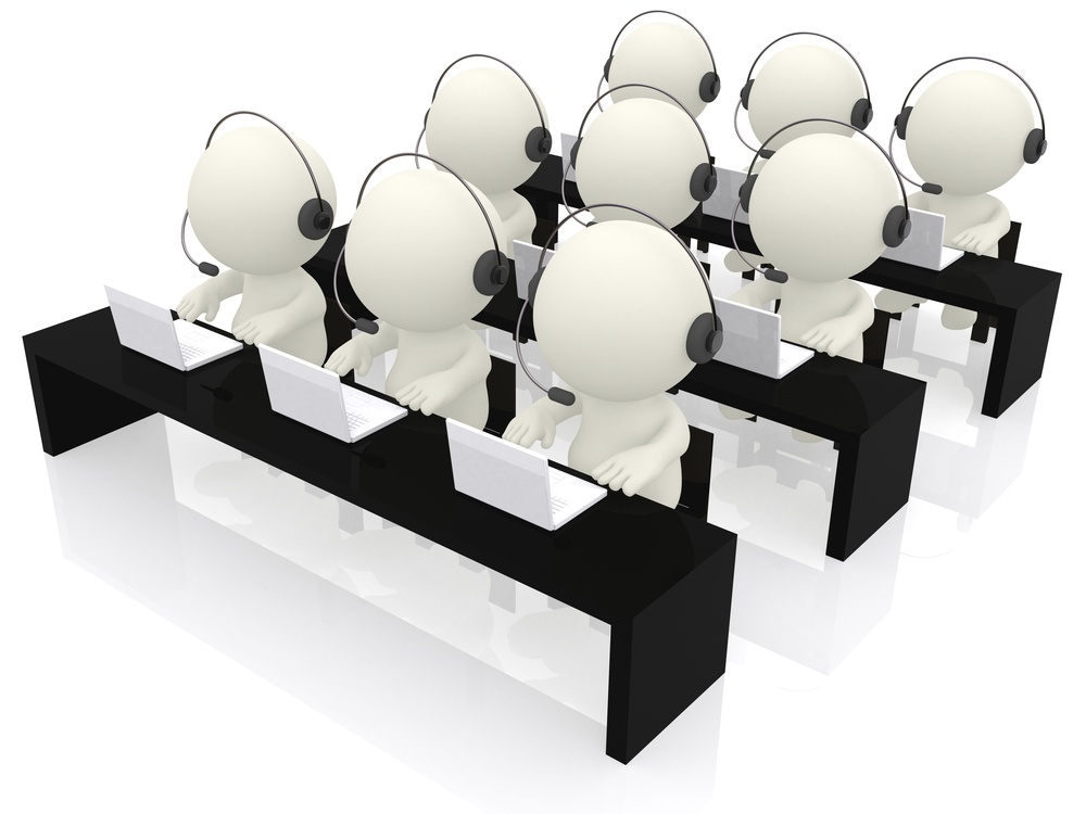 Call center operators sitting at their desks - isolated over a white background.jpeg