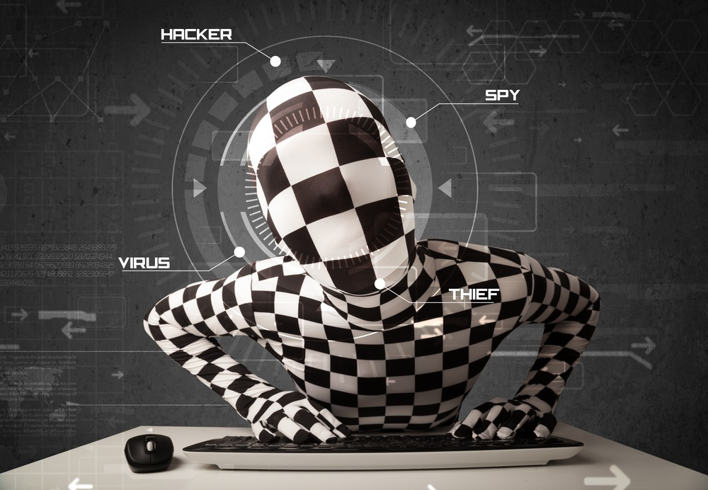 Hacker without identity in futuristic enviroment hacking personal information on tech background.jpeg