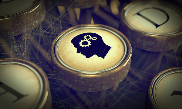 Head With Gears on Old Typewriter Button. Education Concept. Grunge Background for Your Publications.