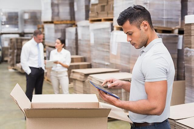 Portrait of male manager using digital tablet in warehouse.jpeg