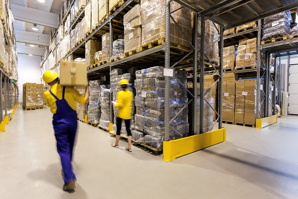 Warehouse worker with box and manager controlling products.jpeg
