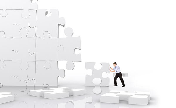 business man making a puzzle isolated over a white background