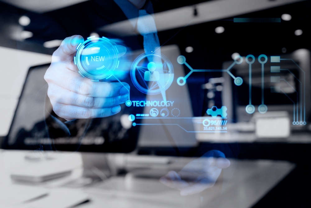 double exposure of businessman hand pushing  new technology button on modern computer as concept.jpeg